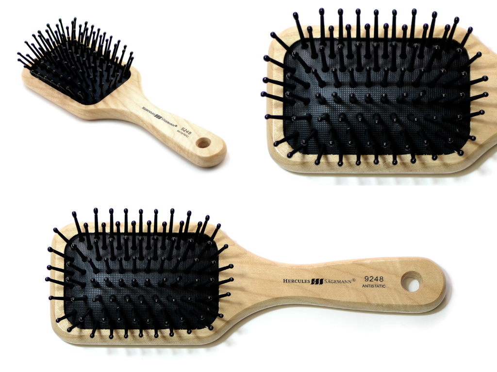 Pocket size paddle hair brush with polyamide pins